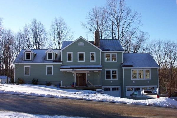Split level Ranch | Two story addition with 3-car garage