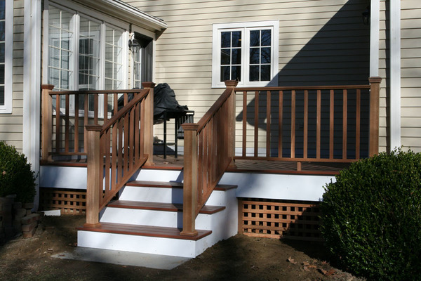 Composite decking (Mahogany Color) with cedar railings and lattice