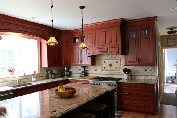 Stained Cherry Cabinets with Black Painted Island