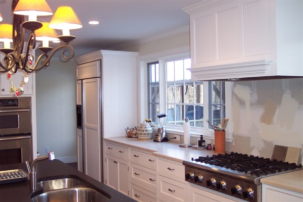 White painted cabinets with contrasting color island